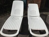 Two Allibert sun loungers with cushions.