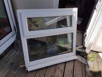 whitw upvc window 100cm x 94 cm. static pane with top opening window.