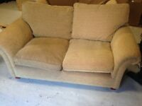 2 brown Sofas and cupboard