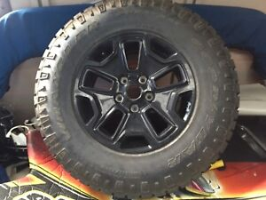 4 jeep tire BF Ko2 and willis rims and one new goodear tire