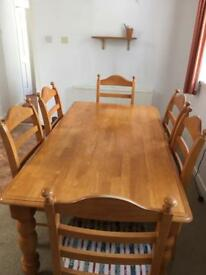Solid heavy pine table and 6 upholstered chairs