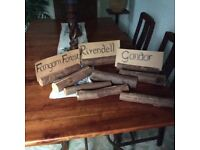 9 yew log table markers, perfect for weddings.