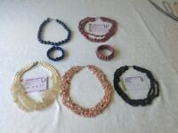 Gemstone collar necklaces with sterling silver clasps and two stretchy cuff bracelets