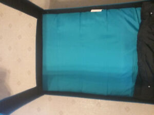 Teal and black playpen