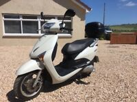 Honda Scooter for sale. Included 2 new helmets.