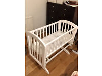 Assembled swinging wooden crib with lock mechanism from John Lewis