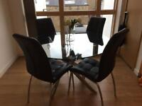 Modern glass table and faux leather chair set