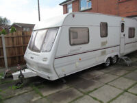 Lunar twin axle 4/5 berth touring caravan 2001 with fixed double bed