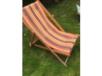Two canvas and wood deck chairs