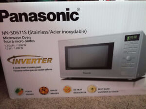 Brand new Panasonic microwave in sealed box, stainless steel