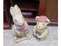 Two stone garden animal figures