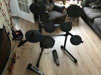 Alesis DM6 Electric Drums with sticks and Stool