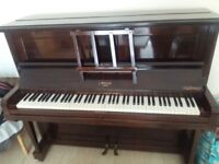 Upright dark wood piano