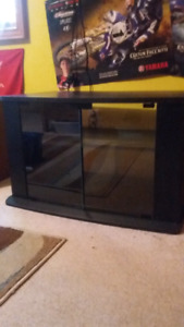 Black TV table with glass doors