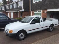p100 sierra shape, white 2 ltr pinto engine, very clean and tidy,fitted watertight tonneau cover.