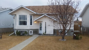 Cochrane 5 Bedroom Home with double garage and fenced yard