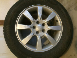 Set of four used 16 inch Nokian summer tires and rims