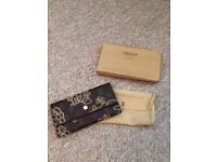 Louis Vuitton purse.
