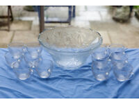 Vintage punch bowl with 12 glass cups.
