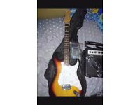 Electronic guitar with amp and accessories