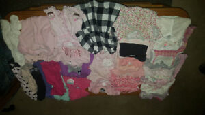 Assortment of baby girl clothes from 0 to 6 months