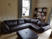 Large brown leather corner sofa and footstool
