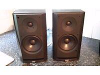 Bower & Wilkins prism bookshelf speakers.