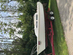 23 ft sailboat with motor and trailer