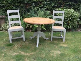 Circular Pine Table with 2 Rush seated Chairs