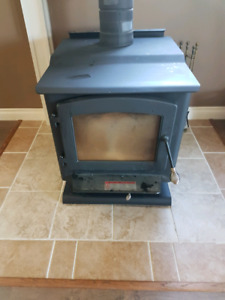 Near new airtight woodstove from Canadian Tire.