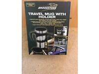 Travel mug with holder