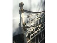 White and brass bedstead