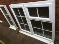 Two used Georgian bar UPVC windows for sale, also front/back door available