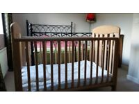 Mamas and Papas cot. Sturdy cot. Good condition. Adjustable sides. Pale wood.