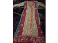 A multi coloured dress for sale in size medium,comes with dupatta shalwar and shameez ...