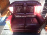 Real leather two seater sofa and matching armchairs