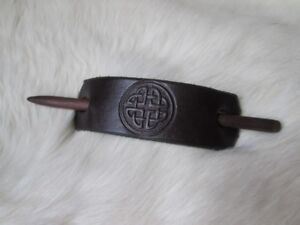 Stamped leather and wood hairpin