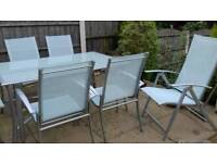 Good quality patio table and chairs