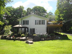 JUST LISTED! PRIVATE 1.49 ACRE WATERFRONT HOME