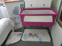 Chicco next to me crib In fuschia. Excellent condition