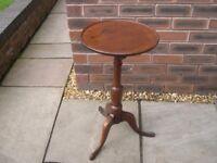 A Georgian mahogany tri-pod table with tilt top.