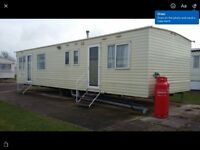 8 berth caravan Trecco bay during August holidays..Baragain £500 per week