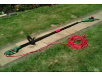 Qualcast 750 watt pole saw,... used once only,..