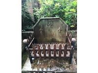 Caste-iron fire grate and back