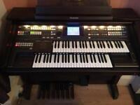 Technics GA3 organ with stool/sheet music/backing cd's