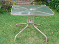 Glass top table with umbrella and 4 folding chairs