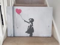 Popular Banksy Canvas print with girl holding heart shaped red balloon