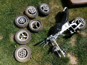 3 sets of pocket bike wheels and a roller chassis