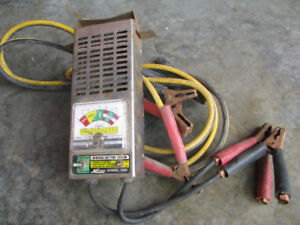 Battery tester in good working condit and a set of jumper cables