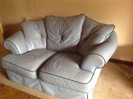 2 x blue leather sofas.